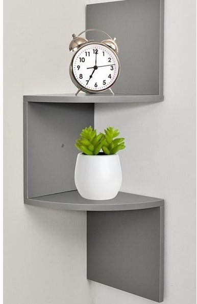 The shelf, which is gray and has two horizontal shelf surfaces that are connected by vertical pieces