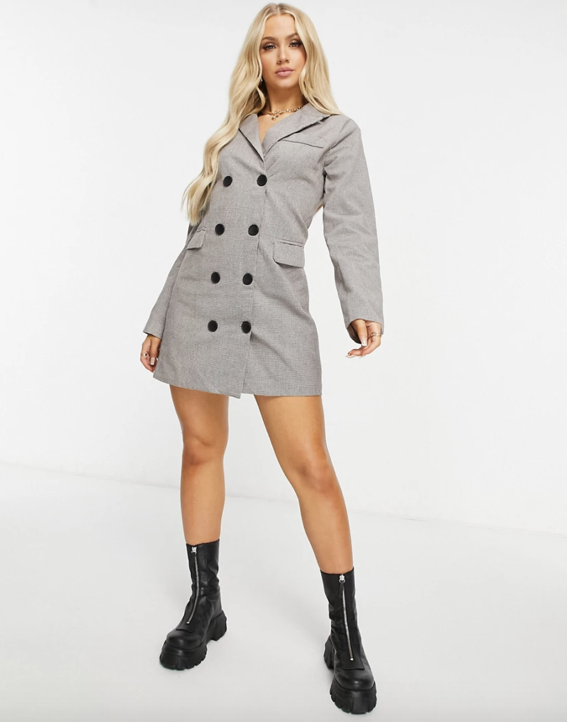 model wearing gray blazer jacket buttoned up with black boots