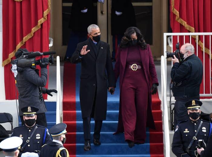 Barack Obama, waving to the crowd, and Michelle Obama descend stars at President Joe Biden's inauguration