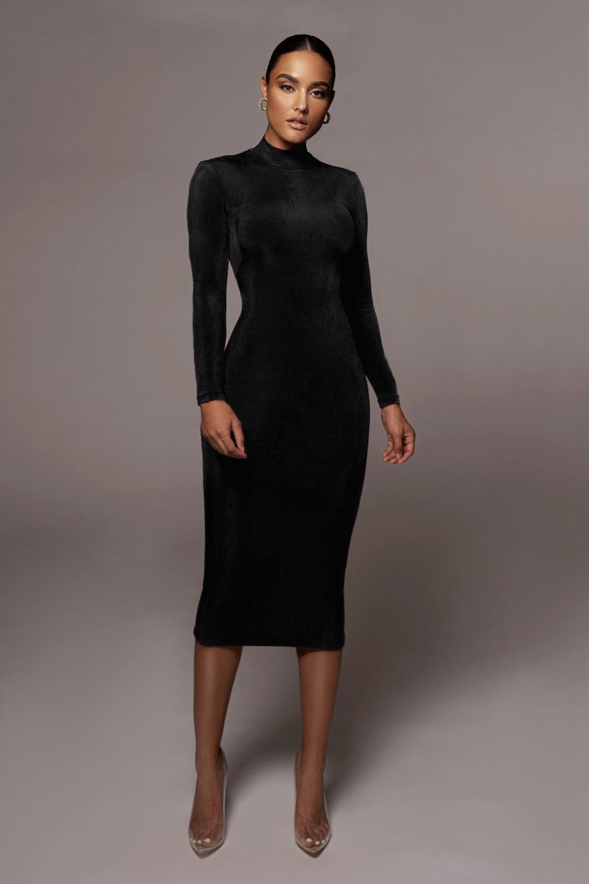 model wearing bodycon black dress with a midi length
