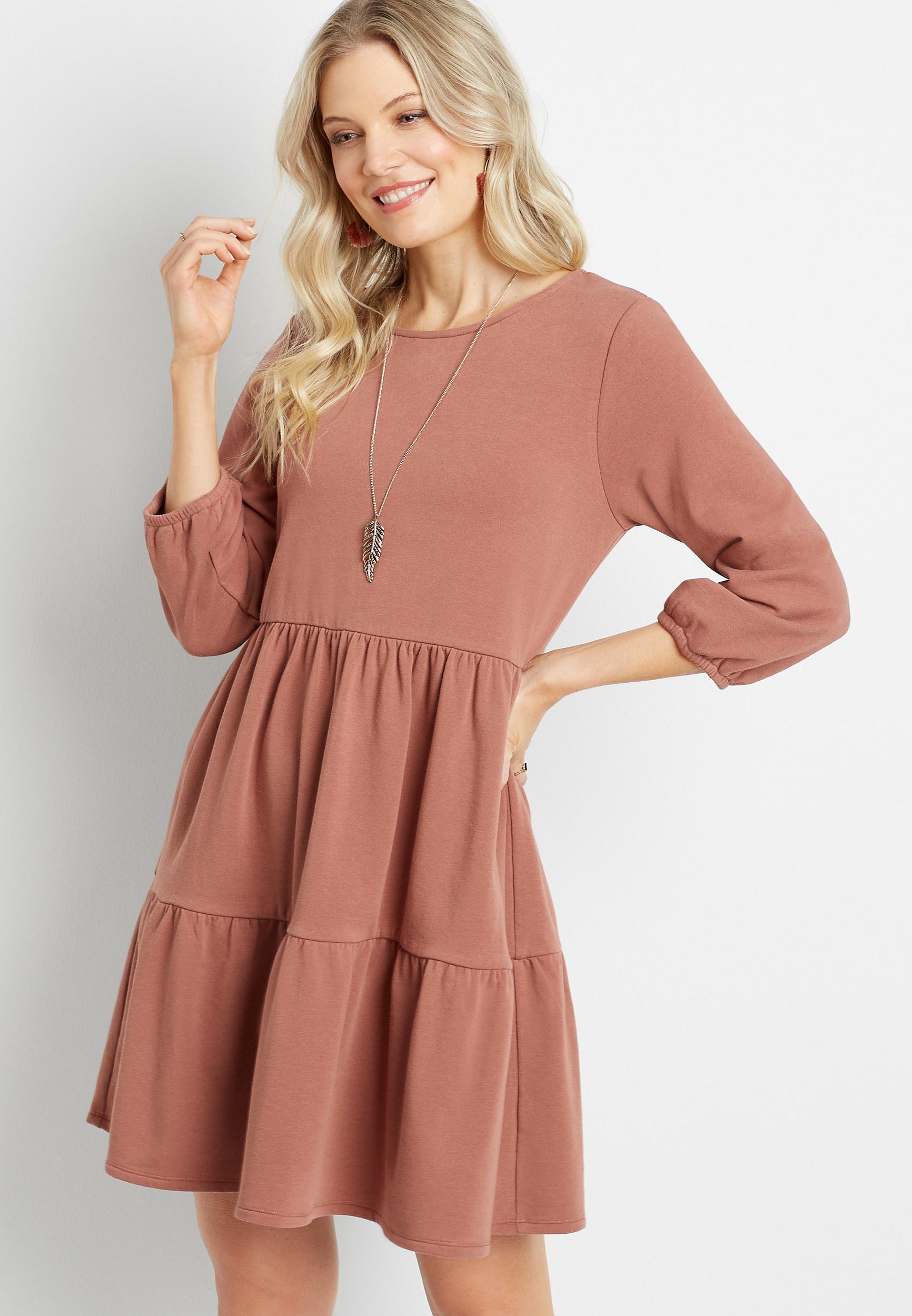model wearing babydoll dress