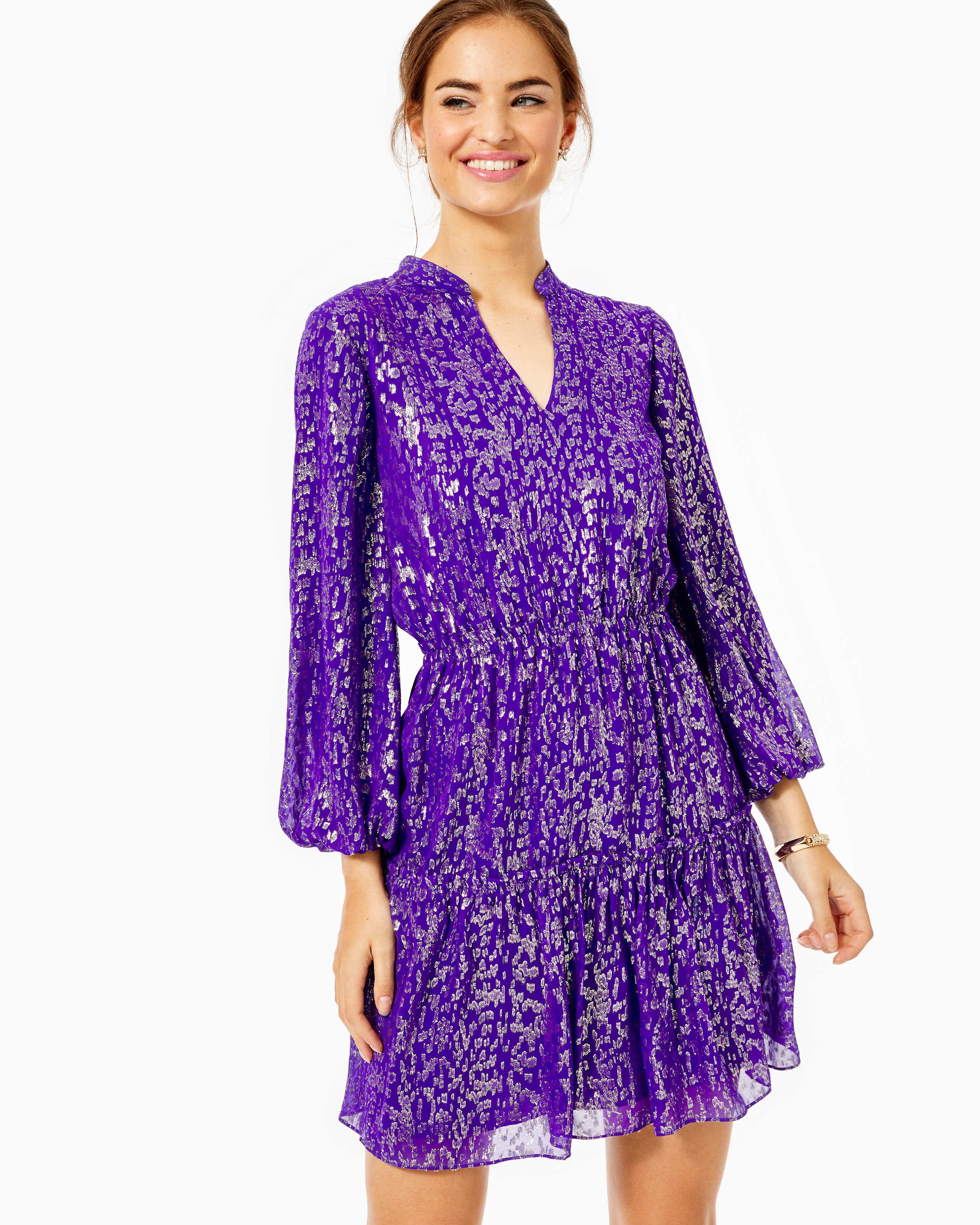 model wearing purple silk dress with long balloon-style sleeves