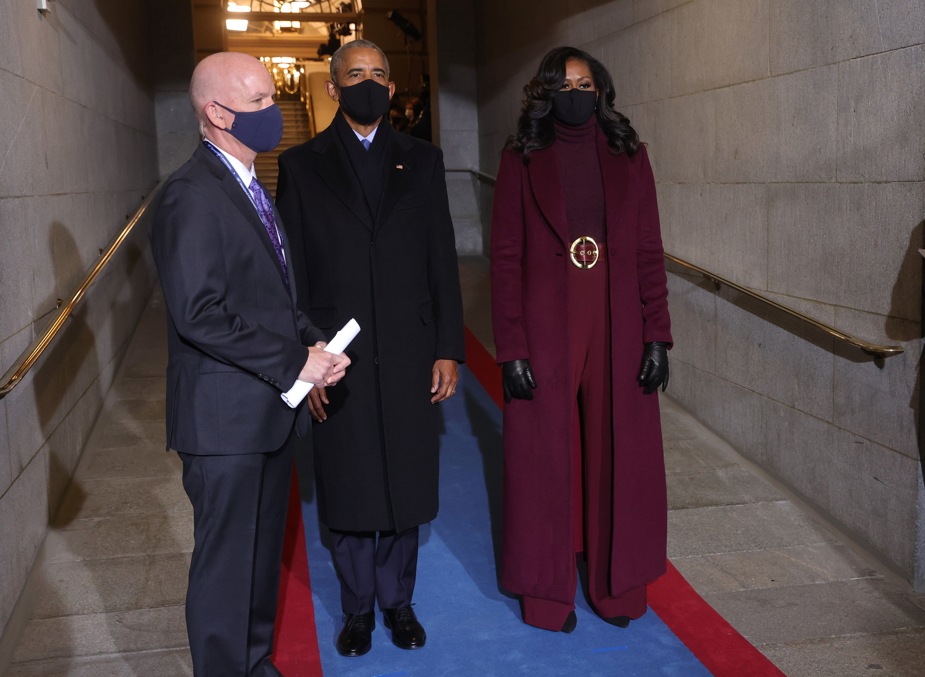 Barack and Michelle Obama stand in a hallway at President Joe Biden's inauguration