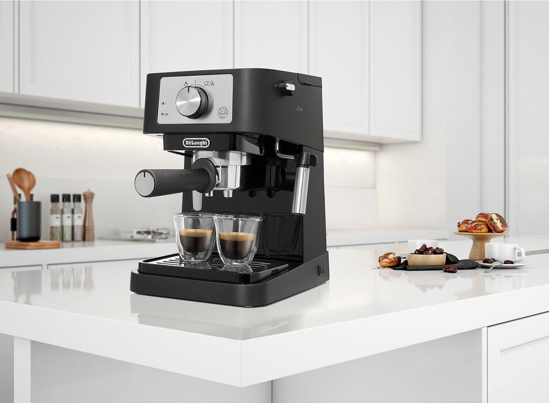 black de'longhi espresso machine with two shots of espresso sitting on a white counter