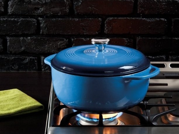 blue enamel cast iron dutch oven on top of a stove