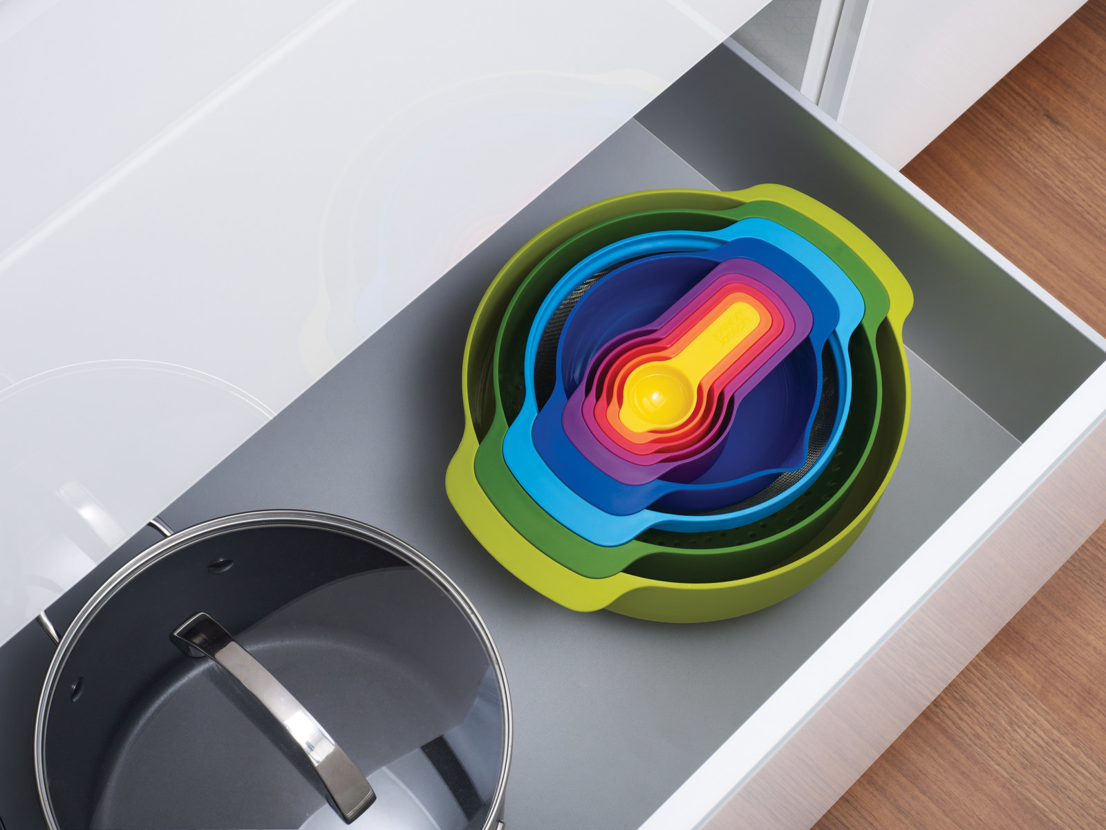 multi-colored nesting bowls in a drawer