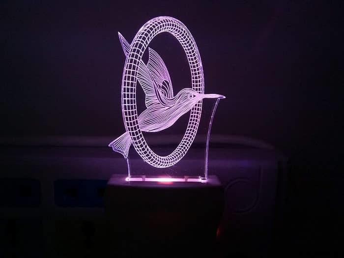 A purple 3D LED bird plug-in light