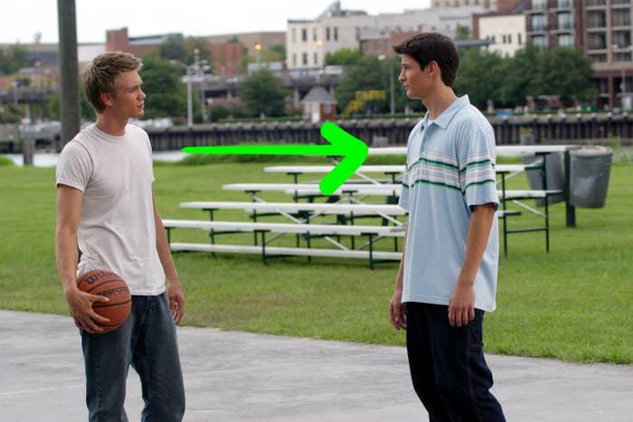 Lucas and Nathan on the river court with an arrow pointing from Lucas to Nathan