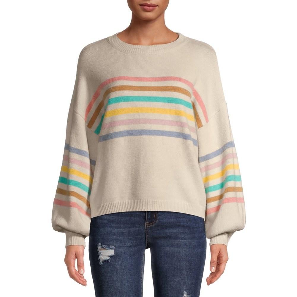Model in rainbow striped puff sleeve sweater