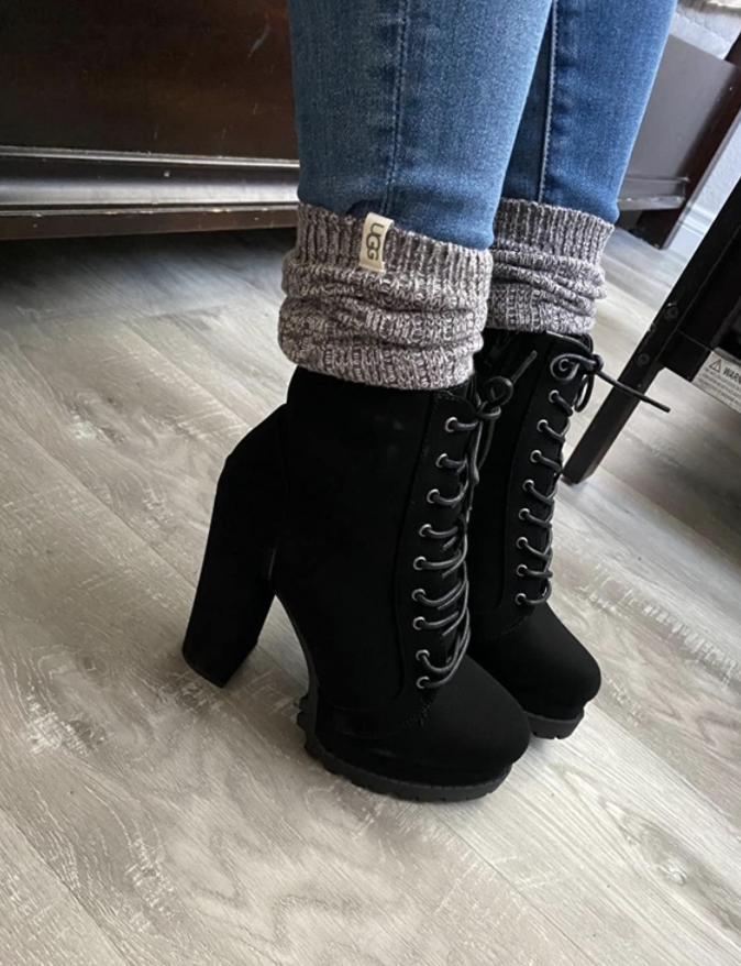 reviewer wearing ugg socks with booties