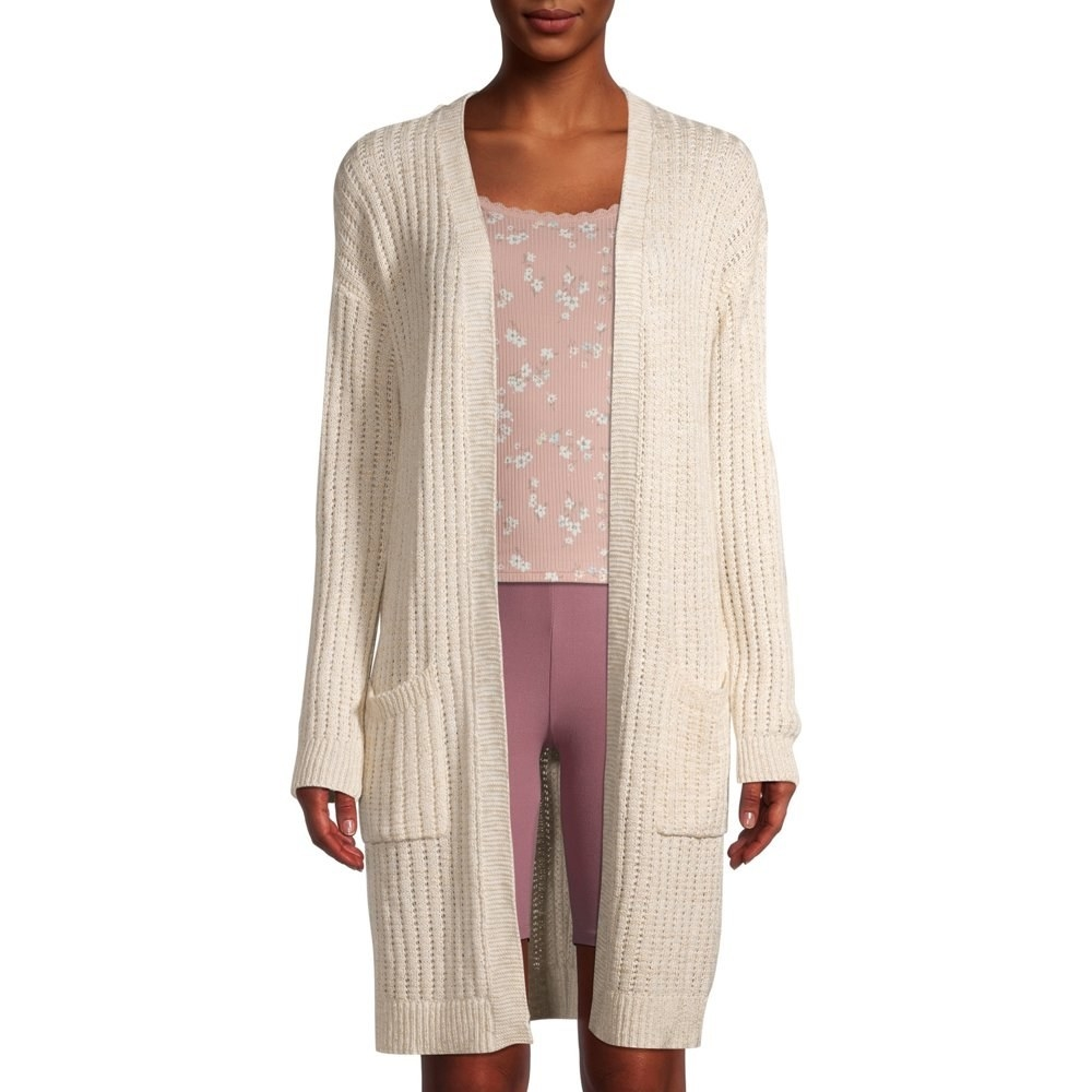 Model in long cardigan with pockets