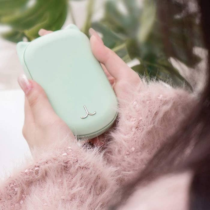 mint hand warmer with cat ears