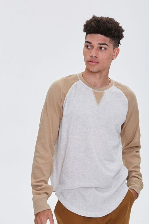 model wearing the brown and white shirt