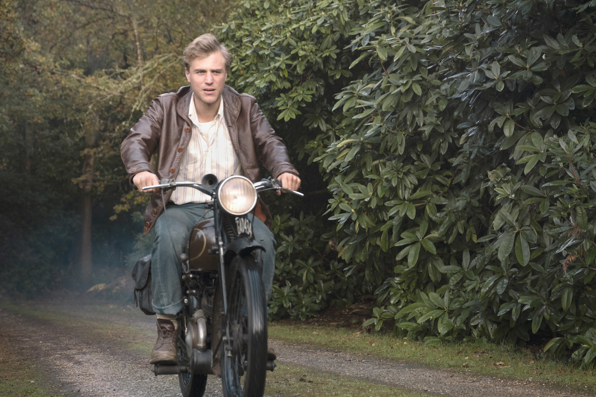 Still from The Dig: Rory Lomax on a motorcycle