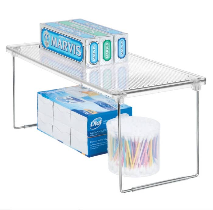 The stackable clear shelf with folding base