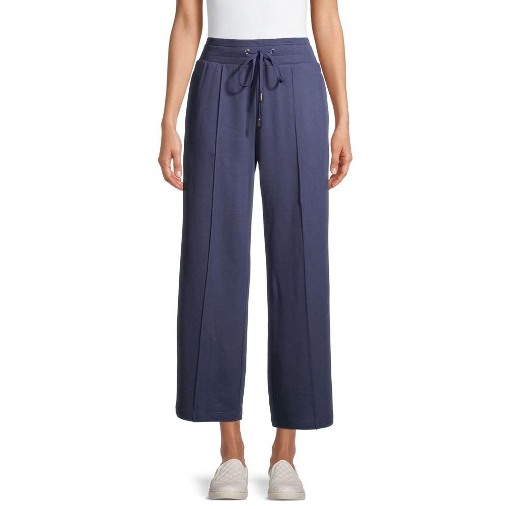 Model in wide leg knit pants