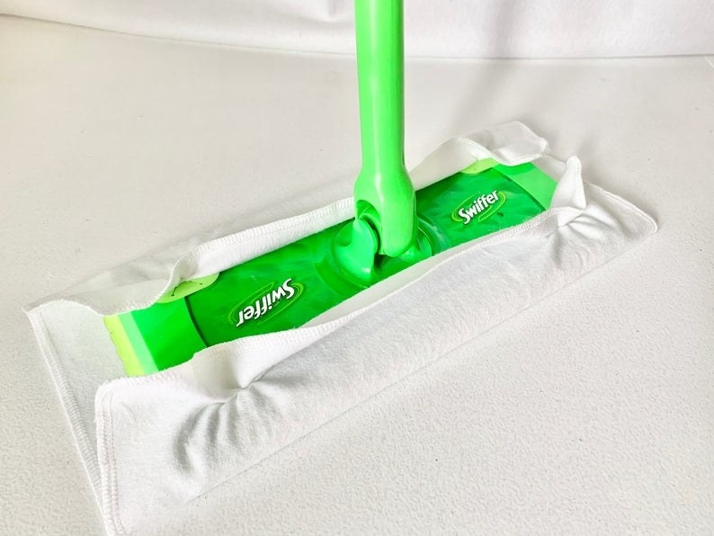 the rectangular white cloth with edges tucked into regular swiffer broom