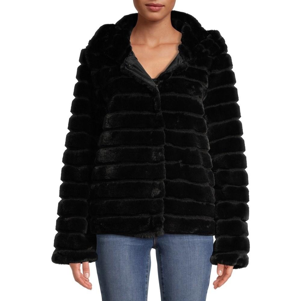 Model in faux fur hooded coat