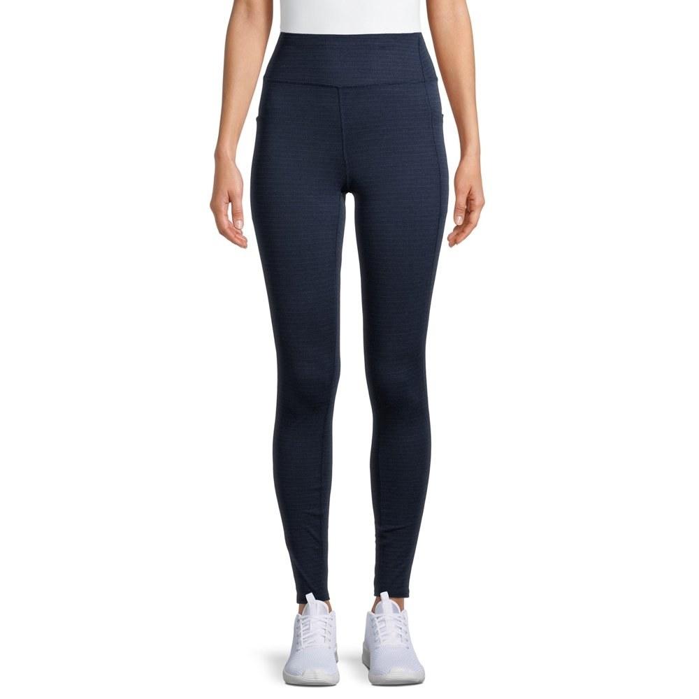 Model in high waist black leggings