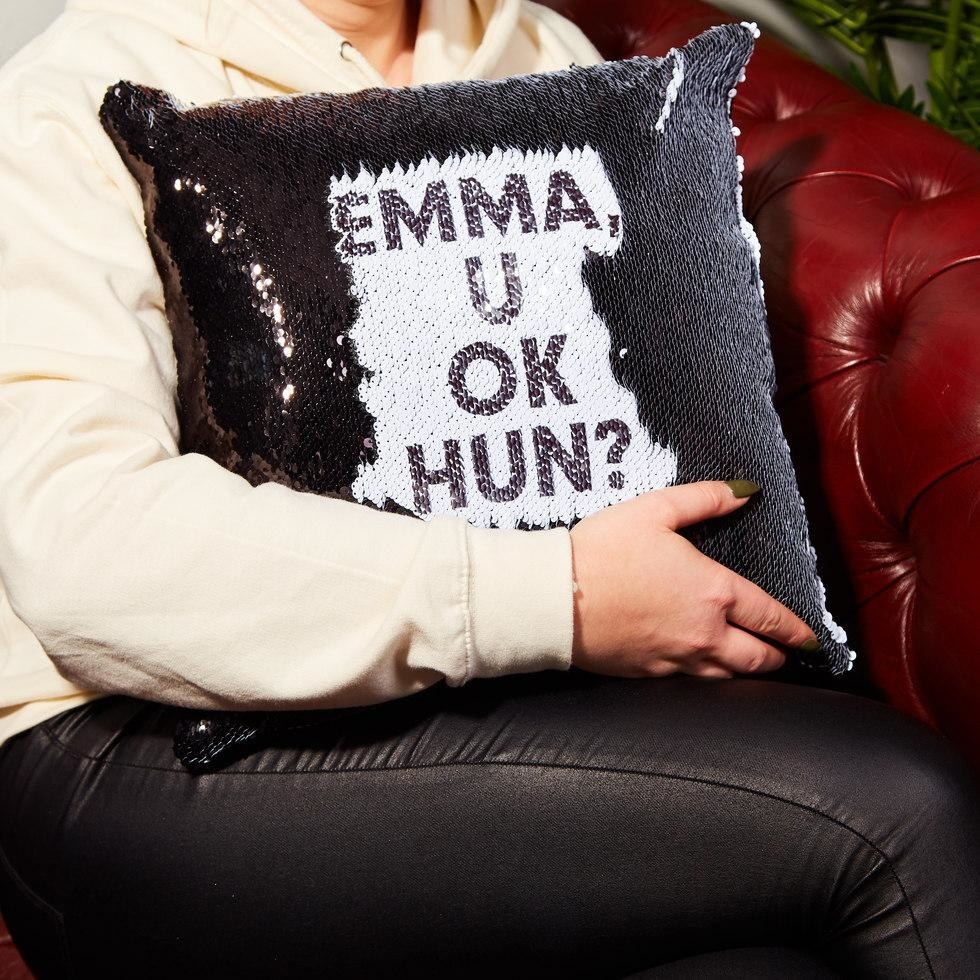 """pillow with black sequins that are brushed to reveal the message """"emma, u ok hun?"""""""