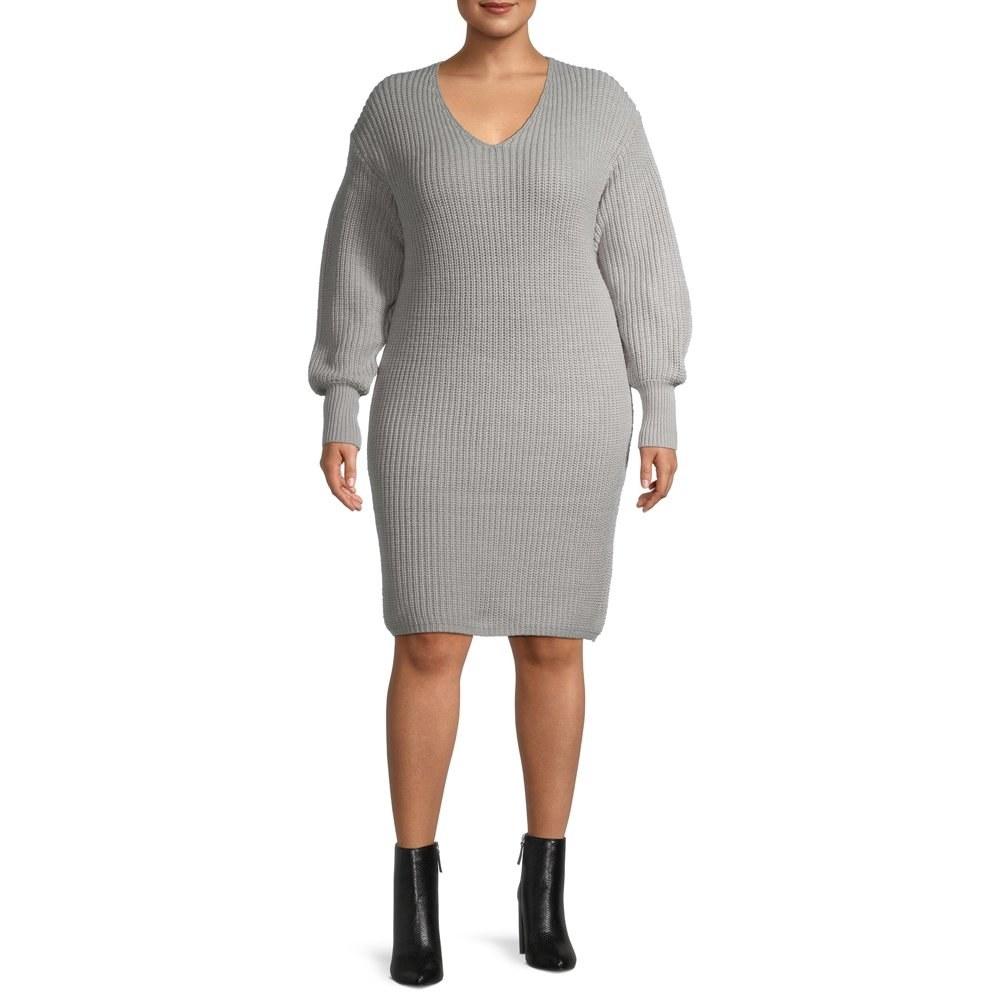 Model in sweater dress