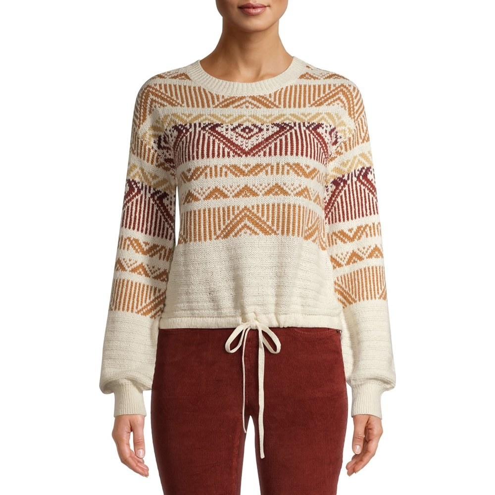 Model in fair isle tie string sweater in ivory and red