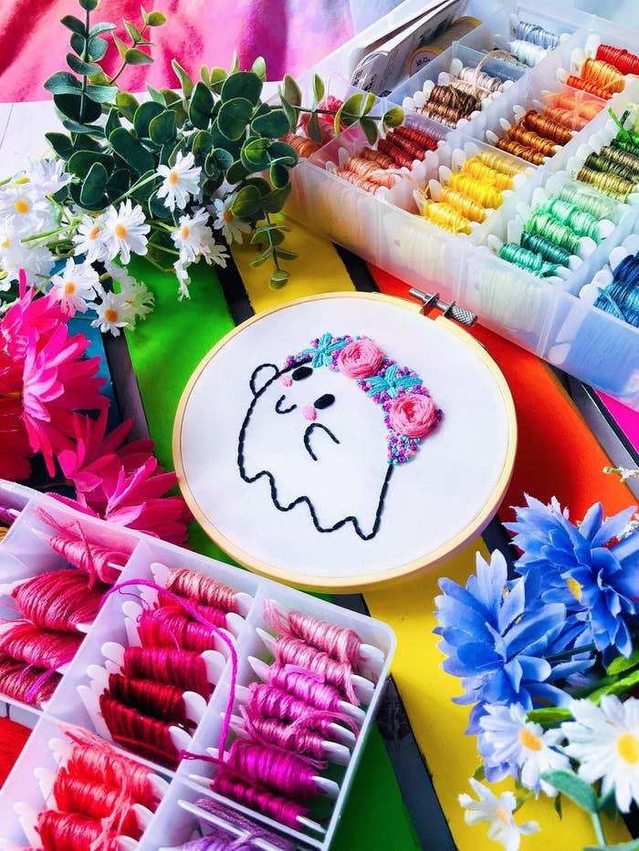 Cartoonish ghost with floral headband
