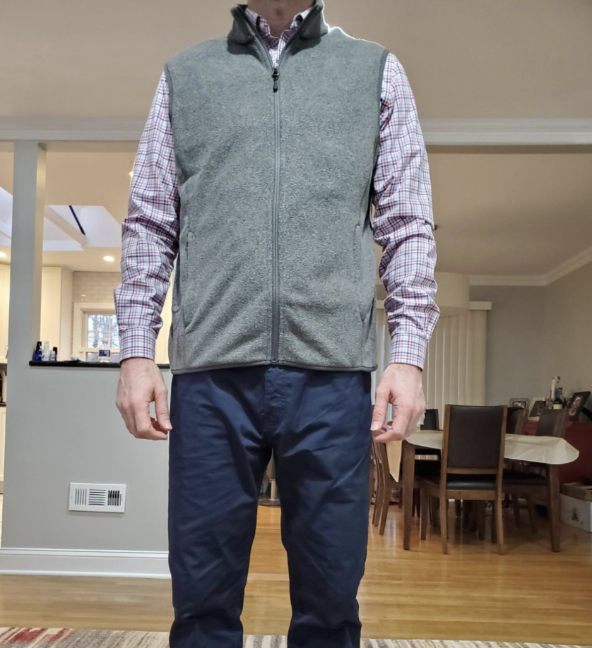 A reviewer wearing the vest