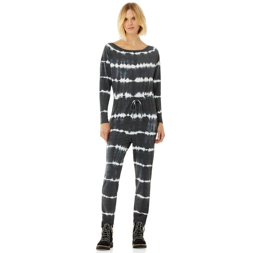 Mode in wide neck jumpsuit with navy and white tie dye patterns