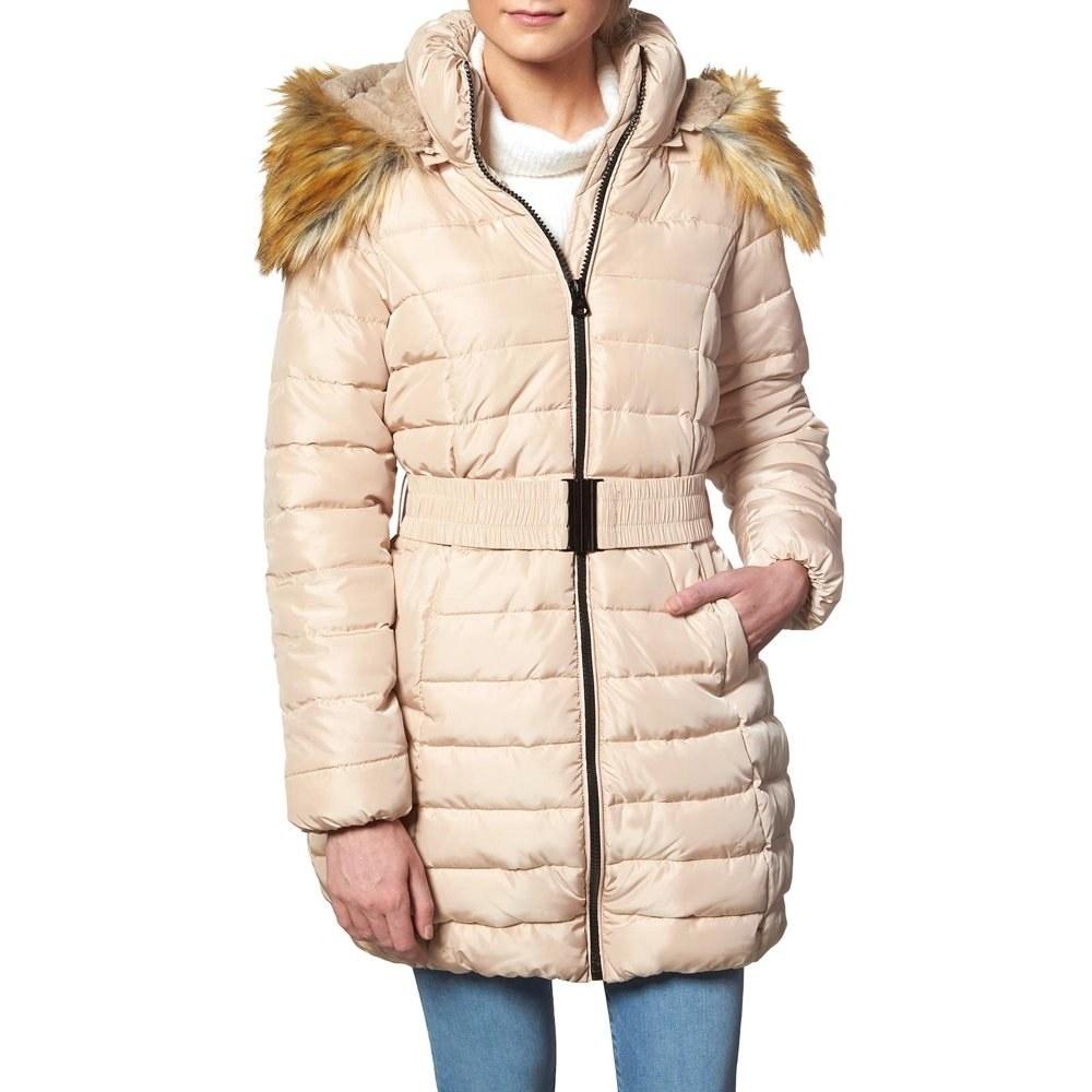 Model in ivory faux fur puffer coat