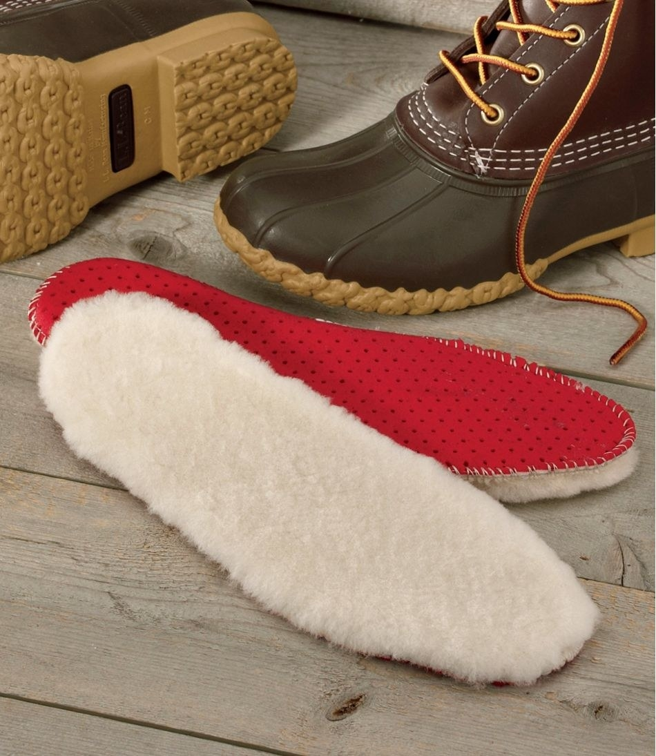 The natural shearling insoles which have a red bottom