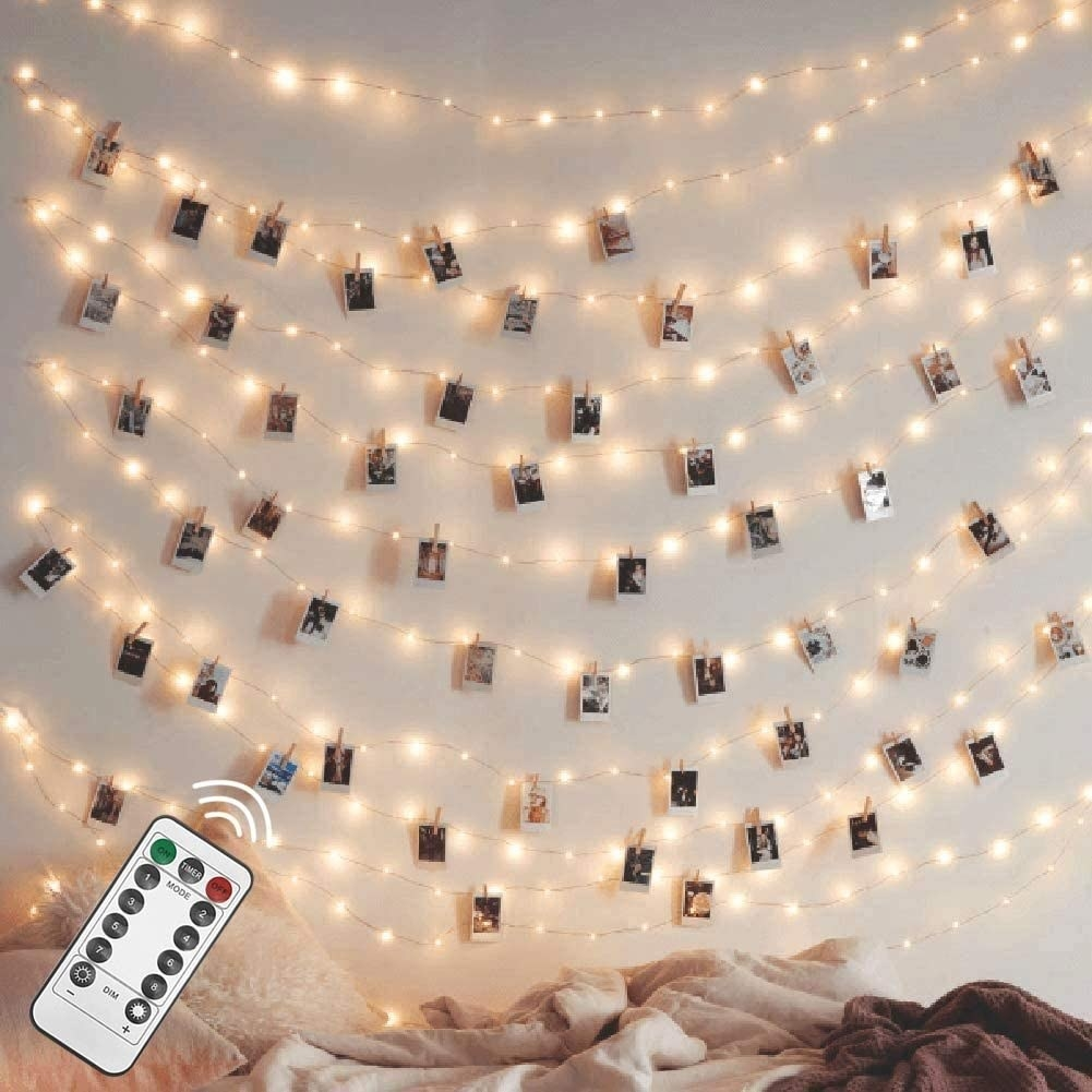 strings of lights with polaroid photos hanging from them