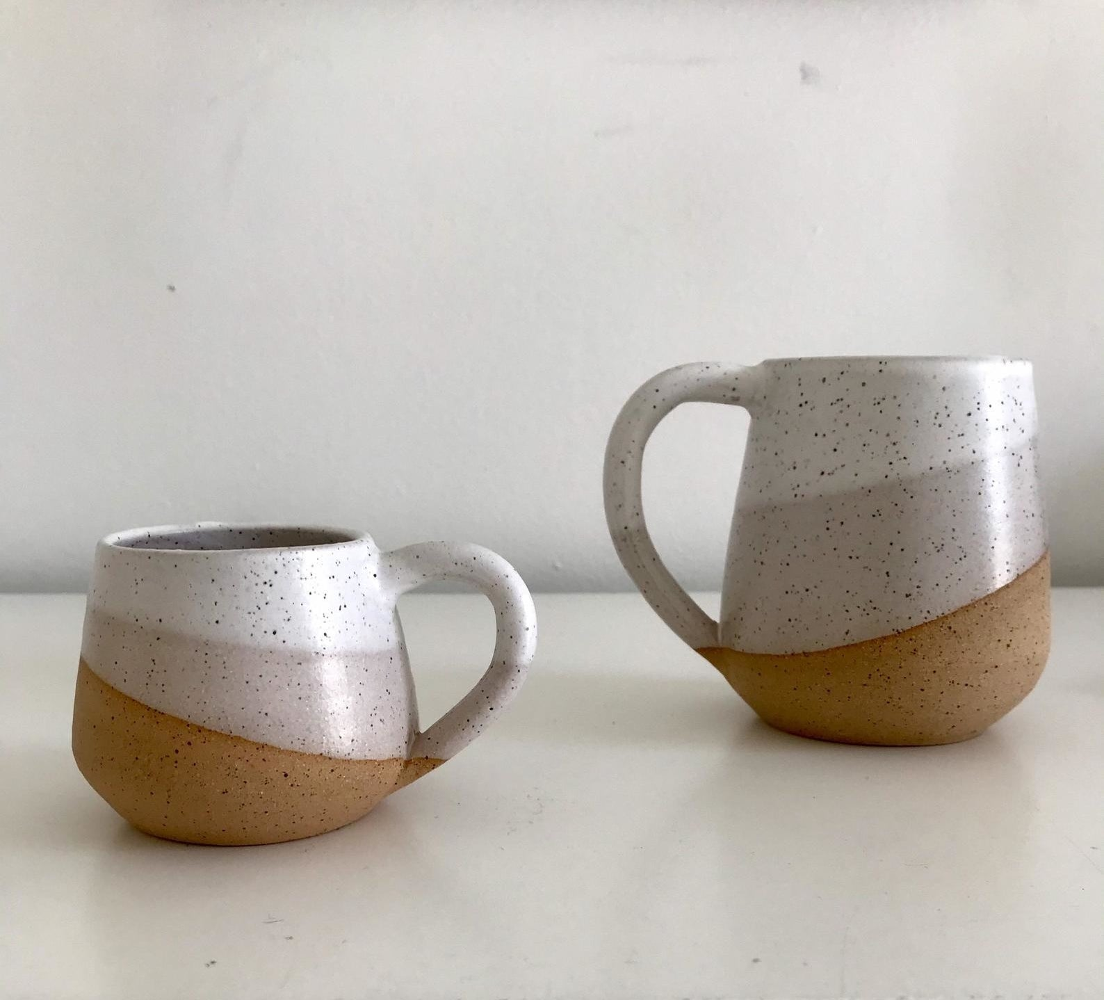 a speckled and white ceramic espresso cup and coffee mug