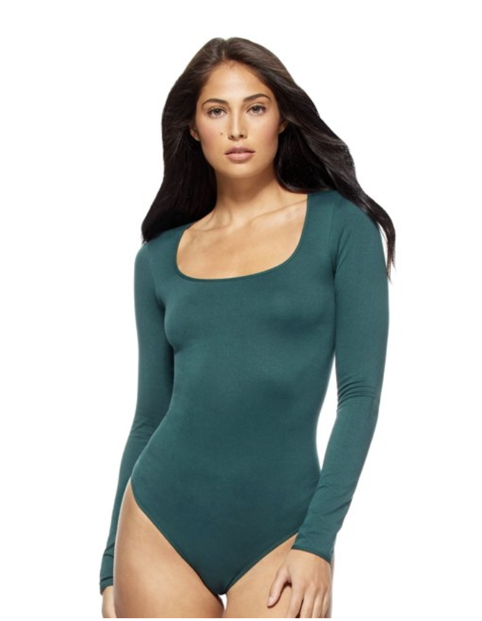 Model in green square neck body suit