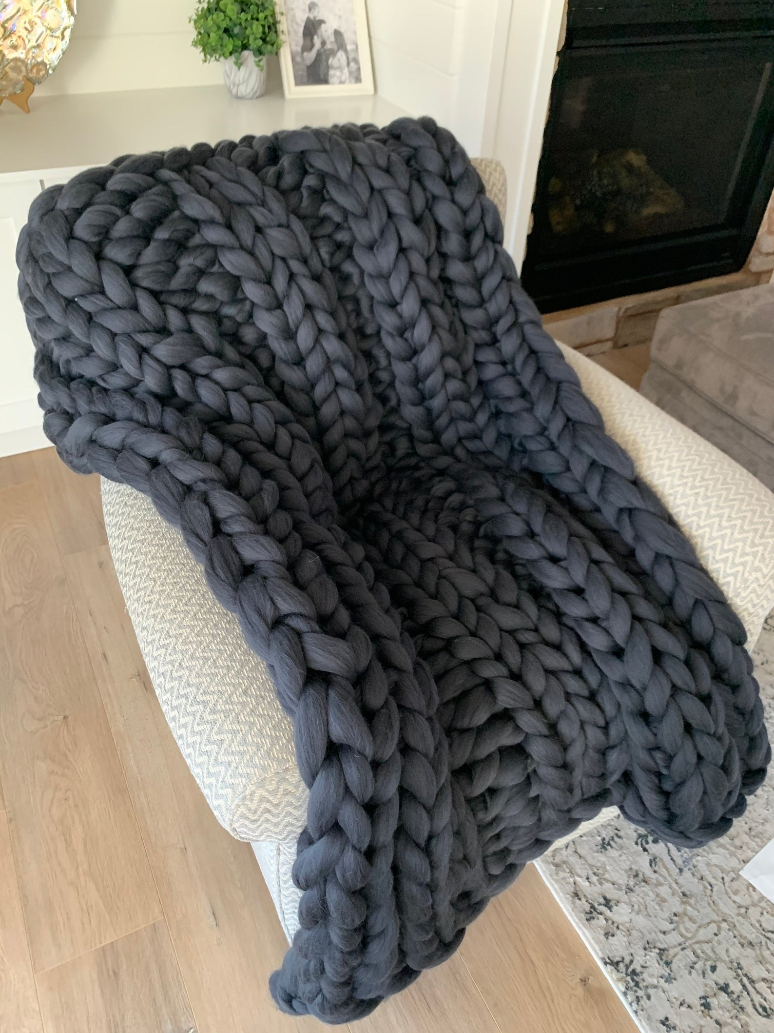 The gray knit blanket draped over a chair