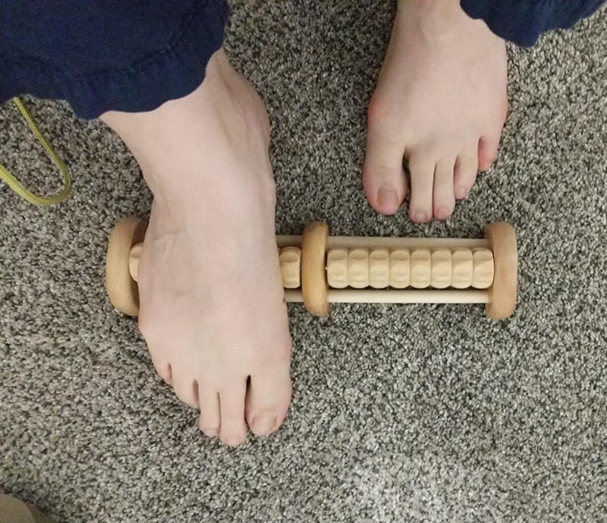 reviewer showing their feet gliding across the roller