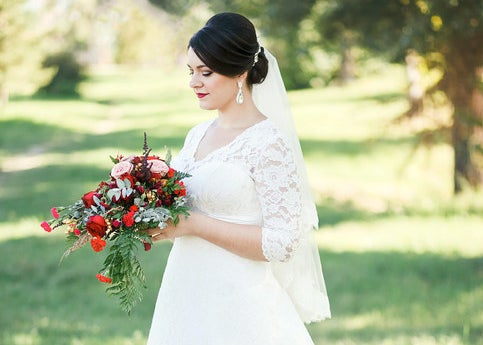 gown with lacey sleeves and plunging neckline