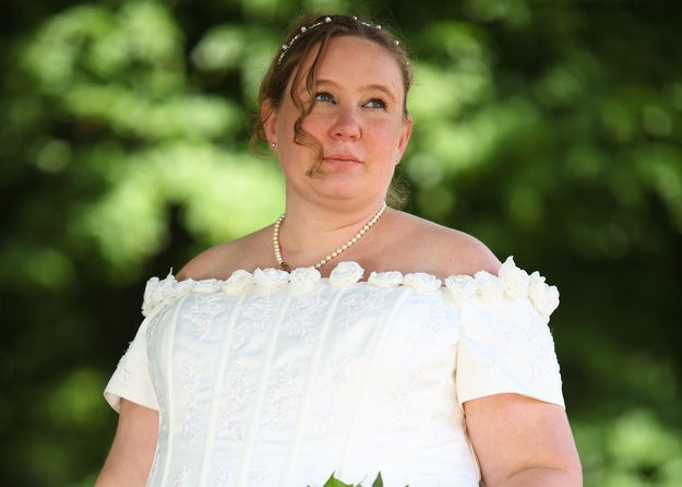 roses along top of off-shoulder gown