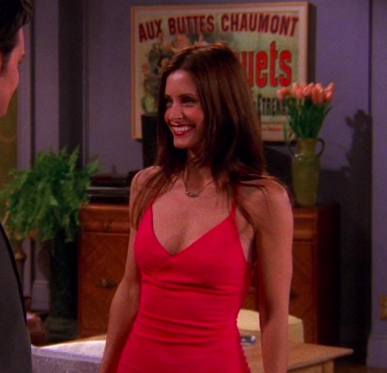 Monica wearing a tight, midi dress