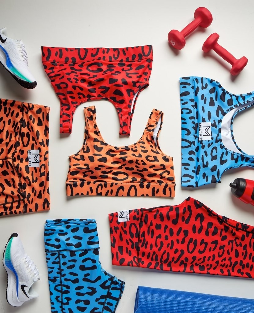 Melt Fit red, orange, and blue leggings and sports bra with a Flintstones-inspired print