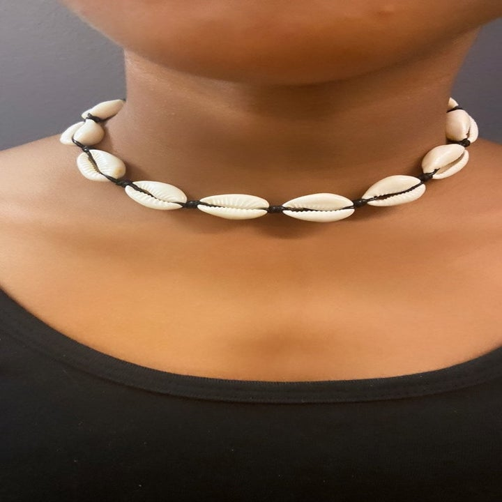 Model wearing the necklace as a choker