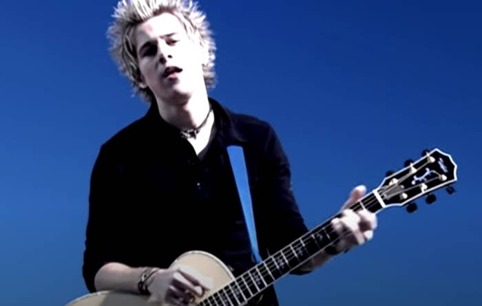 """Ryan Cabrera playing the guitar in the """"On the Way Down"""" music video"""