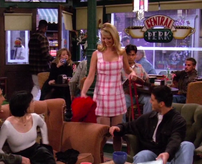 Phoebe wearing a plaid dress