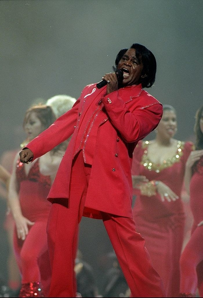 James Brown on stage in an all-red suit