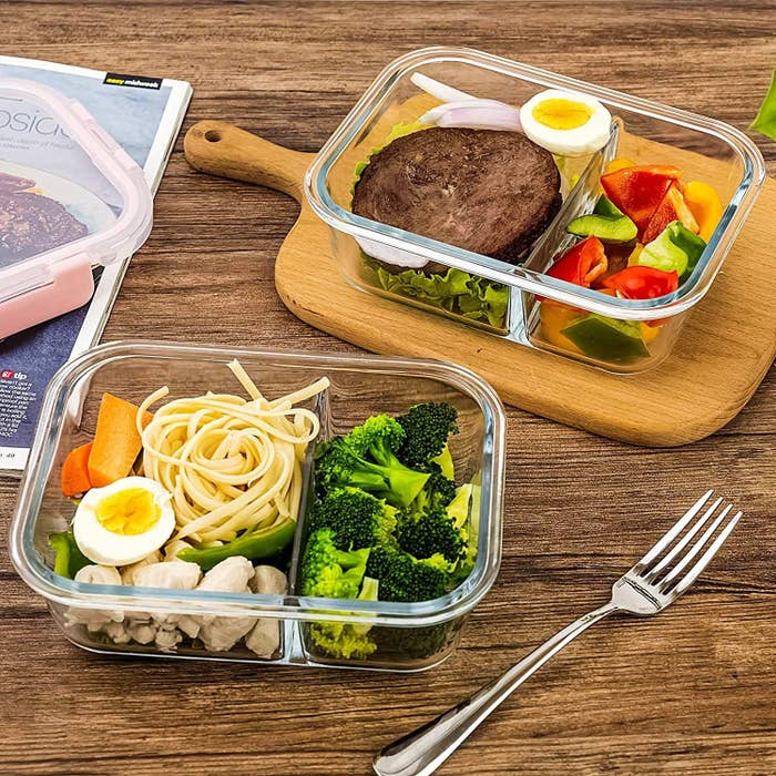 two glass meal prep containers full of food