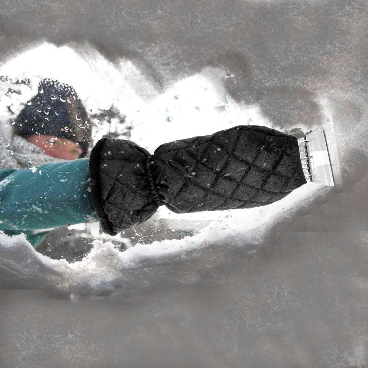 A model using the mitt to scrape snow off of a windshield