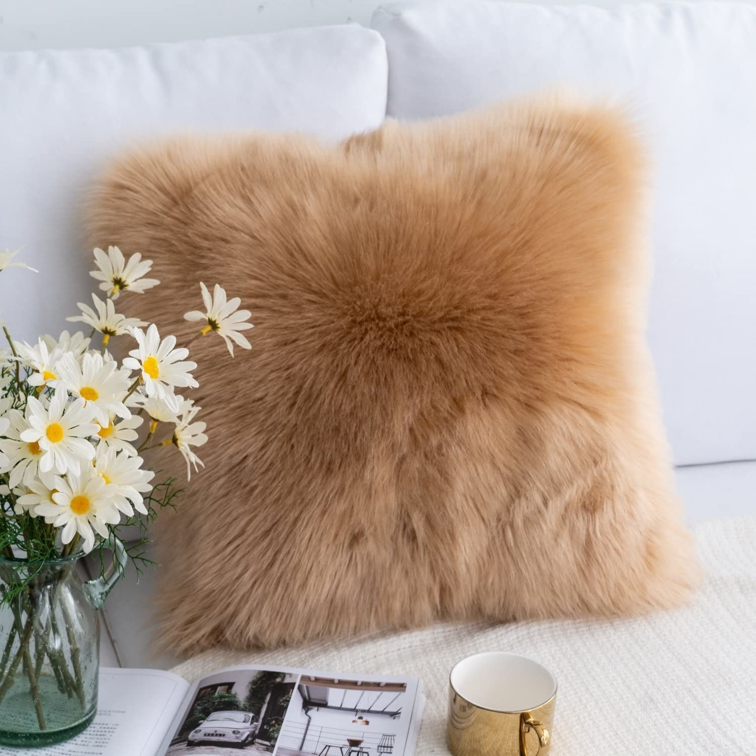faux-fur fluffy pillow styled on couch