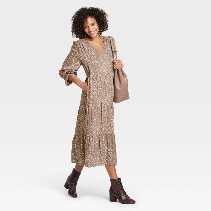 Model wearing brown printed ruffled dress