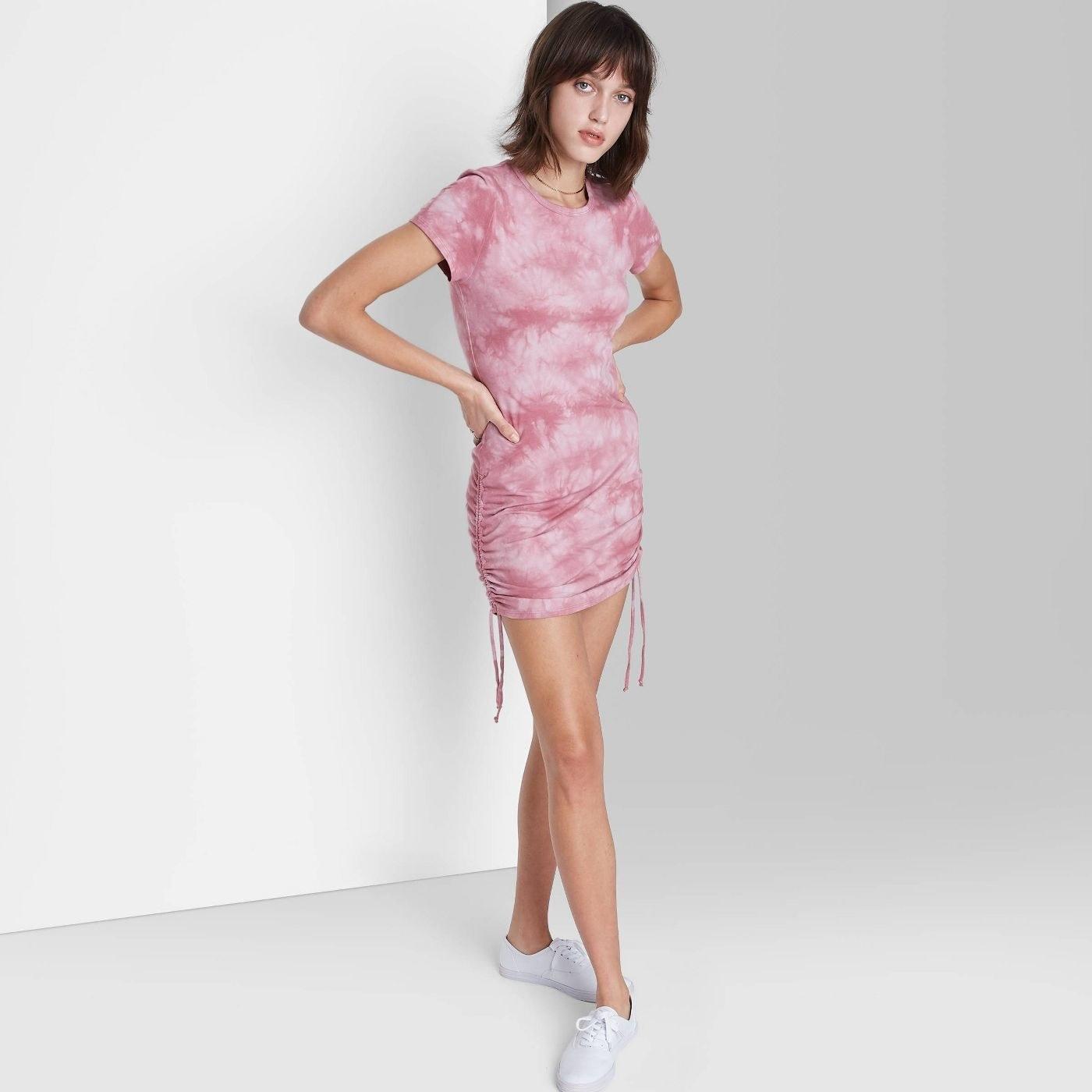 Model wearing pink mini tie dye dress