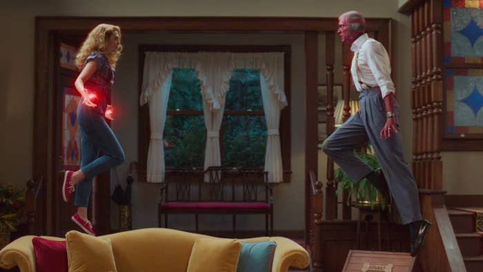 Wanda and Vision floating in the air using their powers, facing off as if to fight